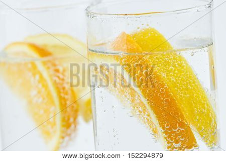 tall glasses of lemon and orange with ice to refresh on a hot summer day