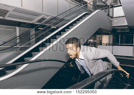 Frightened Man Run Away. Stressed Businessman. Scared Man.