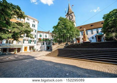 City square near saint Peter church in the old town of Zurich city in Switzerland