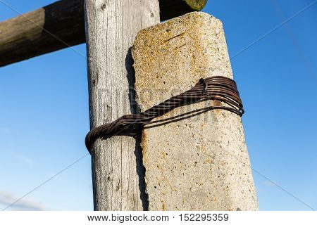 Old wooden poles - the line of electricity transmissions