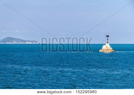 Lighthouse With Deep Blue Sea And Cloud Sky Background