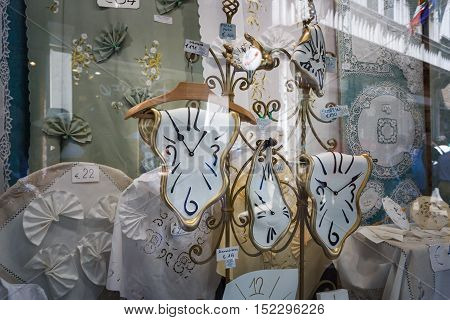 Venice Italy - May 05 2016: The clock Dali style in the window of a souvenir shop