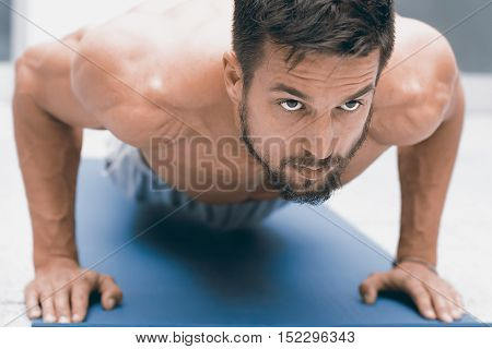 Strength And Motivation. Young Handsome Man Doing Push-up At Gym