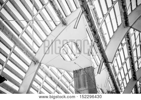 Factory, forged steel structure, metal roof with metal bars and beams