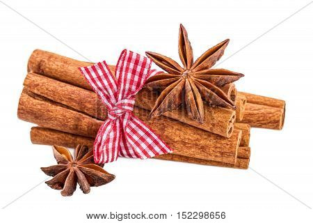 Cinnamon sticks bundle and anise over white.Traditional Christmas spices isolated on white.