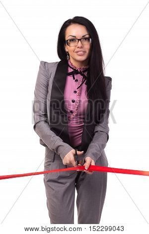 Happy business woman cutting red ribbon opening ceremony isolated on white