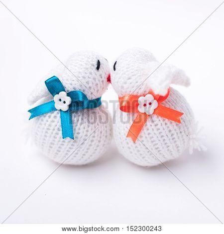 Funny knitted rabbit toy isolated on white background with soft shadow
