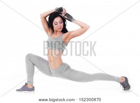 sporty woman fitness pilates exercices isolated on white