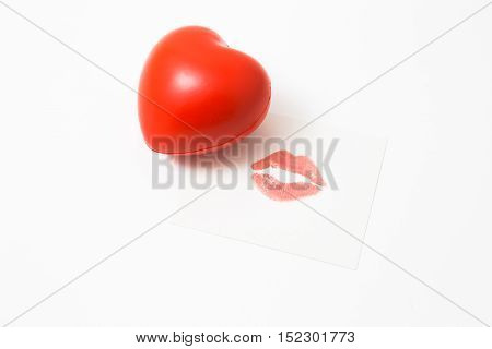 Tender kiss and cute heart isolated on white background