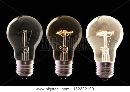three lamp bulb halogen with different luminosity against black background