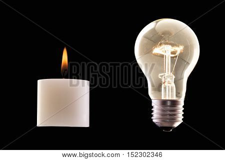candle and halogen lamp both lighted against black background