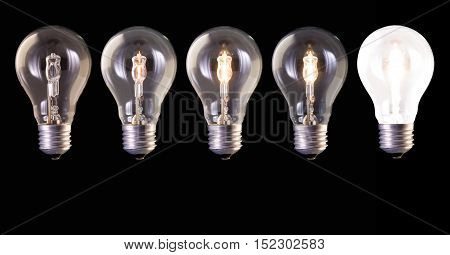 five lamp bulb halogen with different luminosity against black background