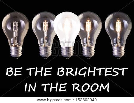 concept idea be the brightest in the room five lamp bulb halogen with different luminosity against black background