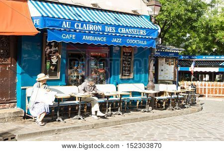 Paris France-July 09 2016: The traditionnal French cafe Au clairon des chasseurs located in picturesque Montmartre district of Paris.