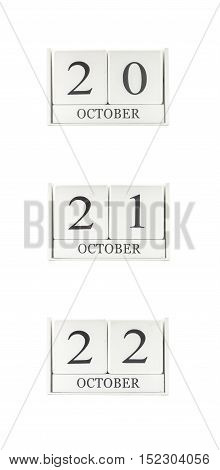 Closeup group of white wooden calendar with black 20 21 22 october word three date calendar isolated on white background