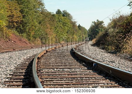 A bend in the railroad tracks and winding through the hills.