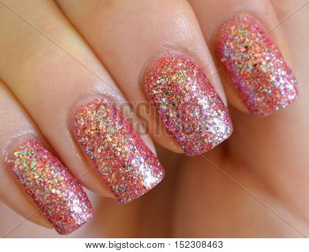 Valentines Day Holiday style bright Manicure of shining pink colored.