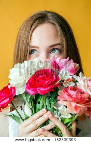 Beautiful and sexy face of woman with flowers
