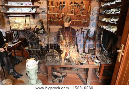 ISTANBUL TURKEY - JULY 29 2016: Old cobbler shop recreation in Rahmi M. Koc Industrial Museum. Koc museum is industrial Museum dedicated to history of transport industry and communications