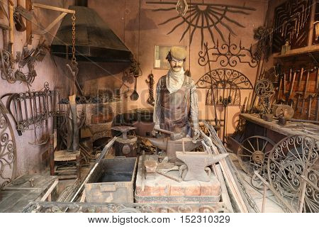 ISTANBUL TURKEY - JULY 29 2016: Old smithy recreation in Rahmi M. Koc Industrial Museum. Koc museum is industrial Museum dedicated to history of transport industry and communications