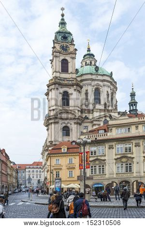 PRAGUE, OCTOBER 15: The Town Belfrey by St. Nicholas Church on October 15, 2016 in Prague, Czech Republic. Prague is full of beautiful historic buildings.