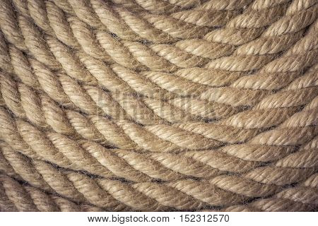 Nautical rope curve as rustic textured background