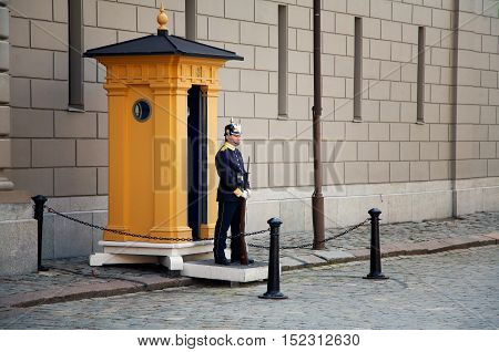 Stockholm Sweden - June 20 2012: A soldier of the Royal Guards at the Royal Palace in Stockholm in front of yellow sentry box.