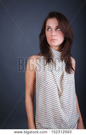 Young romantic woman on dark gray background