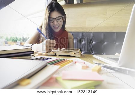 Collegian woman reading book in library. Education idea concept. Reading and researching for exam. The student life.