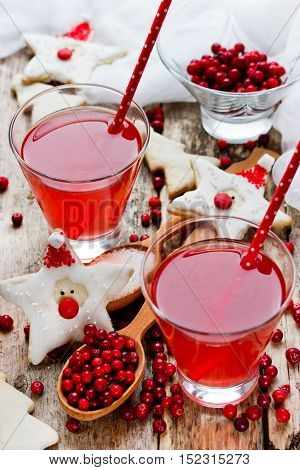 Cranberry juice or drink and funny cookies shape santa healthy Christmas treats for kids