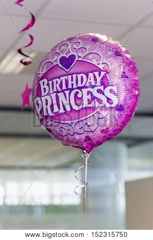 Ljubljana Slovenia -March 18 2016: Birthday Princes pink helium balloon birthday party in office