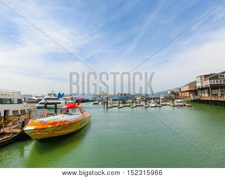 San Francisco California United States of America - May 04 2016: The sailing boats at Fishermans Wharf at San Francisco USA. Fishermans Wharf gets its name in the mid to later 1800s when Italian fishermen came to the city.