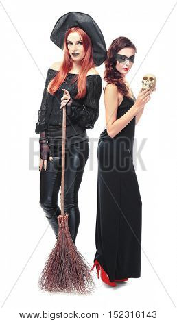 Young women dressed as witch and vampire for Halloween, isolated on white