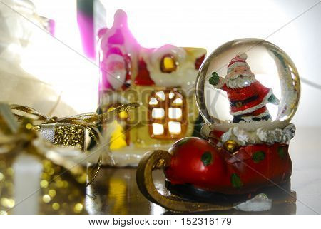 Christmas still life with Santa's snowball and lights in the background selective focus