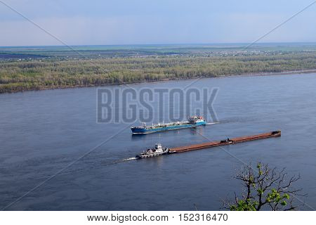 ship floats on the river business shipping