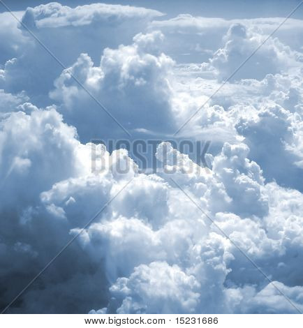 kind on clouds on a background a firmament from an airplane