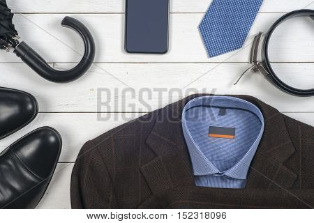 business clothes on a wooden background. set of men's clothing and shoes on wooden background. Top view. Copy space for text.
