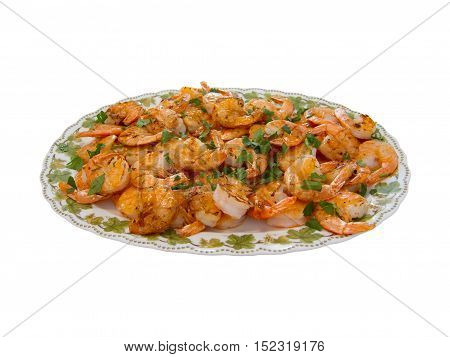 A plate with cooked scampis and herbs isolated
