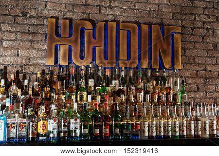 GRODNO BELARUS - NOV 7: Alcohol bottles on a bar at the gastrobar HOUDINI in Grodno Belarus November 7 2015