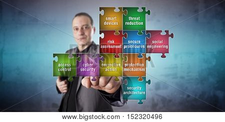 Corporate IT manager with calm facial expression is touching a jigsaw piece labeled cyber security in an incomplete computer security puzzle. Information technology and crime prevention concept.