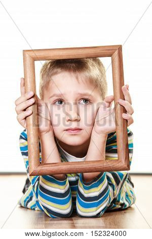 Little Sad Boy Child Framing His Face