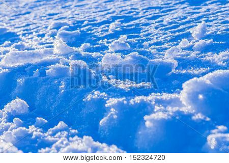 abstract snow outdoor background with back-lighted snowdrift