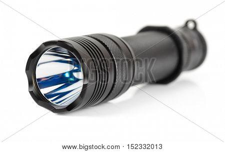 Military tactical LED flashlight isolated on white background