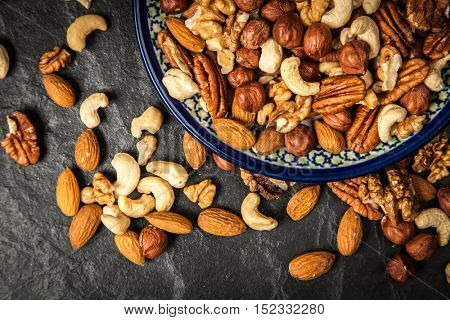 Mix of different nuts closeup photo