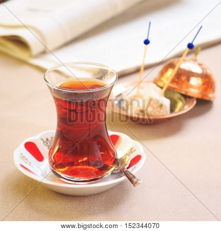 Cup Of Turkish Tea With Locum On Oriental Plate. Concept Of Turkish Tea.