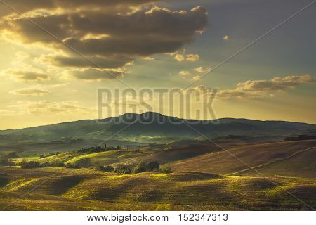 Volterra rolling hills on sunset. Rural landscape. Green fields and hills in backlight. Tuscany Pisa Italy Europe