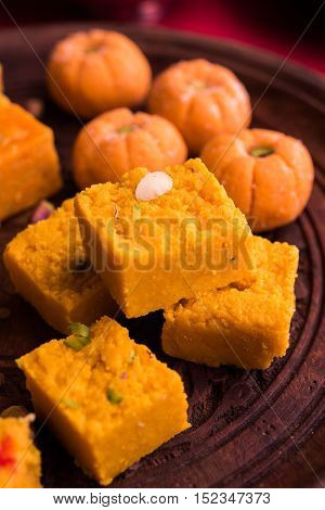 almond, pista, mango and orange flavoured pedha and burfi Indian sweet dish made from milk , dry fruits and fruits, diwali food