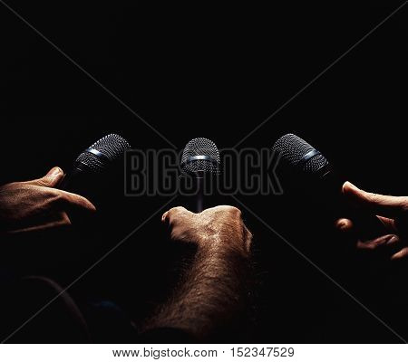 Three Microphones In Hands