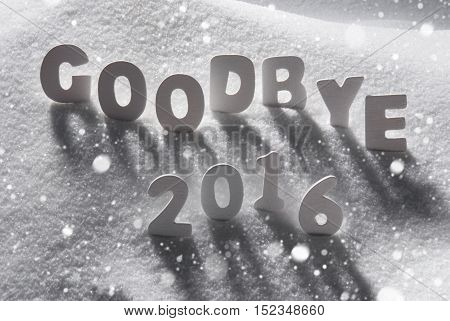 White Letters Building English Text Goodbye 2016 In Snow. Snowy Scenery With Snowflakes For Happy New Year Greetings.