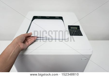 isolated woman with paper sheet from printer